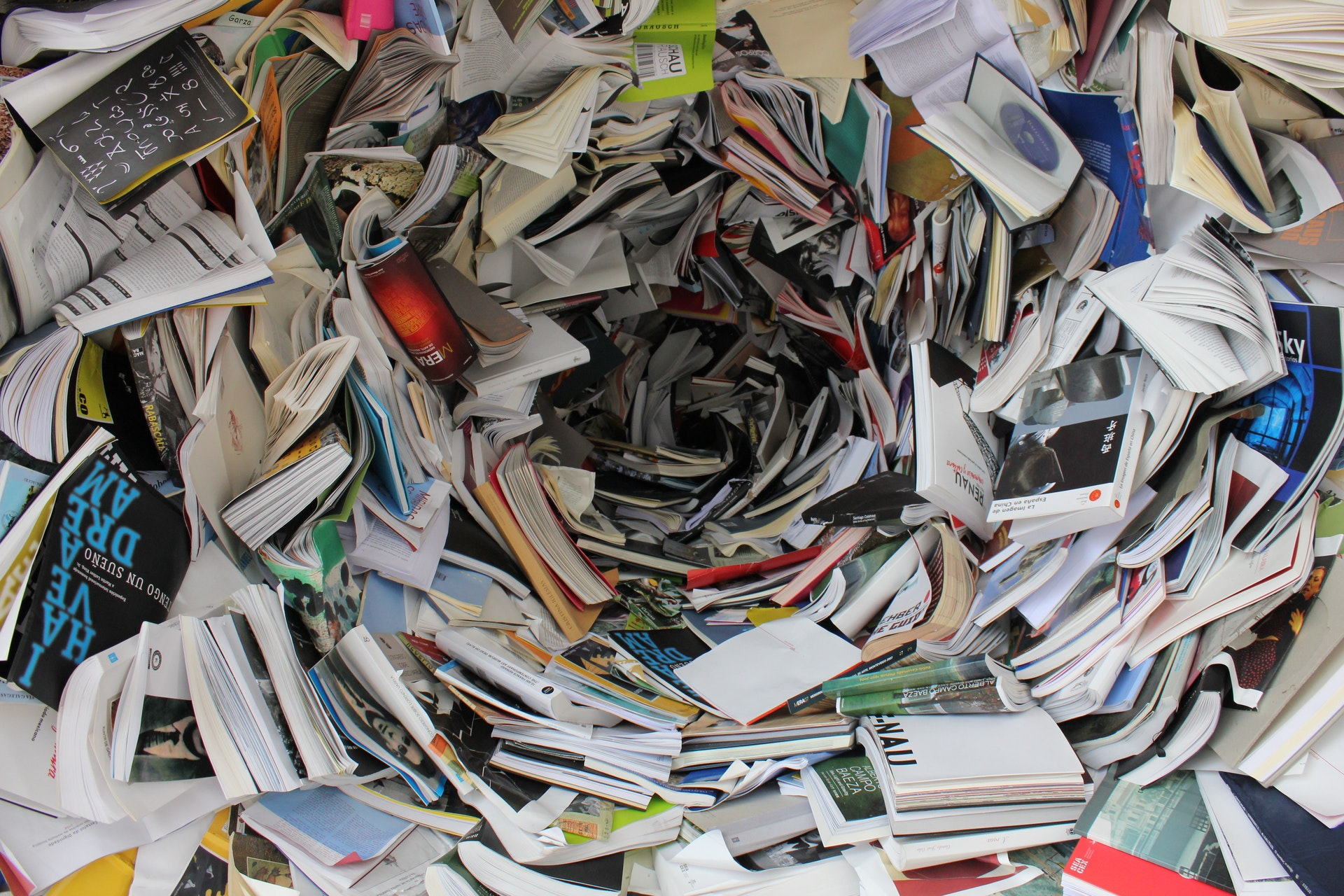 A pile of novels swirling, depicting that many books make it difficult to distinguis between a good corporate thriller and a bad one